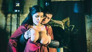 The black knight Xander Corvus gets his dick sucked by the busty red witch Romi Rain