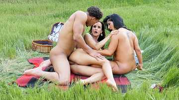 Two impressive cougars Lisa Ann and Raven Hart shared black cock outdoors