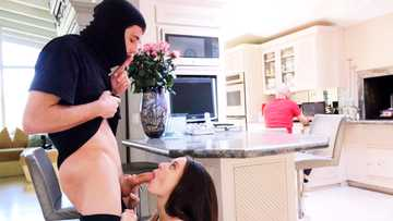 Teen Lana Rhoades gives her masked boyfriend deepthroat in the kitchen